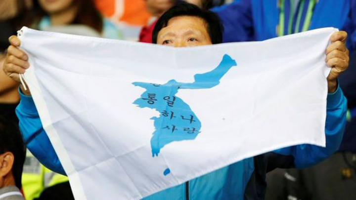 north and south korea march under one flag olympics