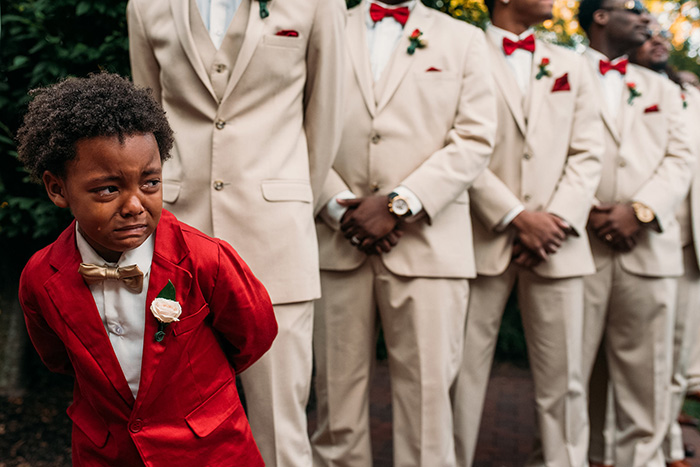 boy in tears at parents wedding