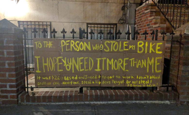 woman makes sign after someone stole her bike and kindness followed
