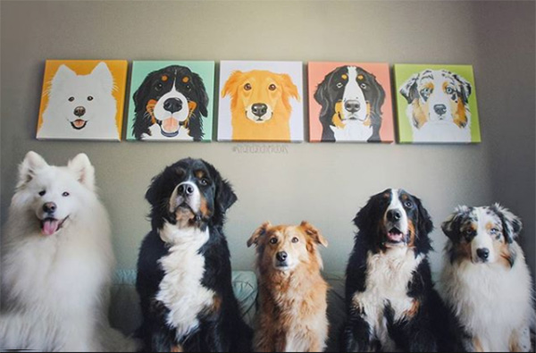 dogs posing by paintings