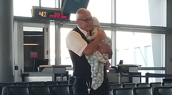 Image result for gate agent offered crying infant