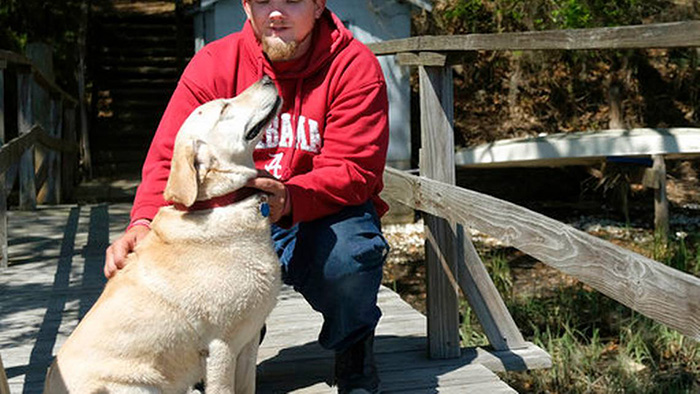 dog saves man from river