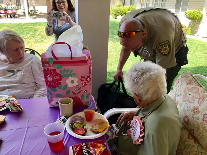 woman surprised with cat 103 birthday
