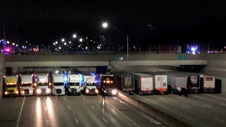 semi trucks line up to stop suicide