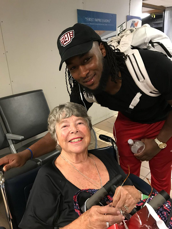 nfl player pushes woman in wheelchair at airport