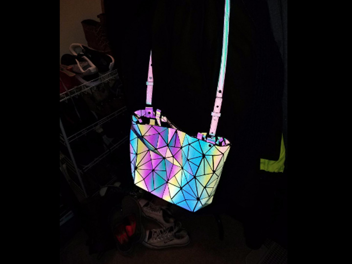 black purse that shines glows with flash