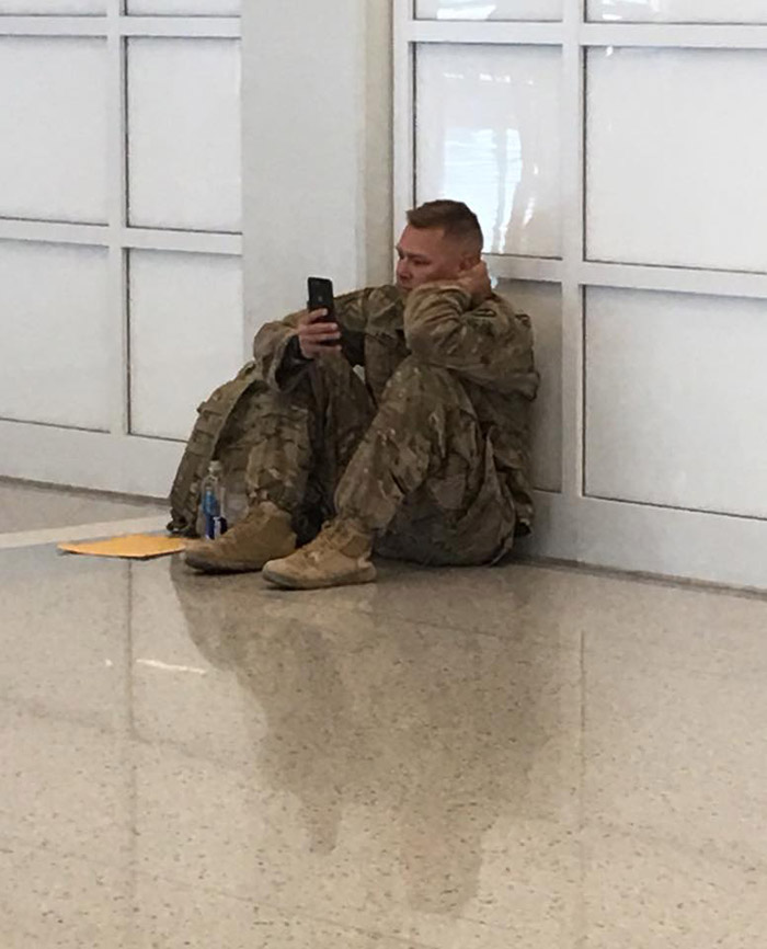 solider watches birth of baby over facetime video at airport