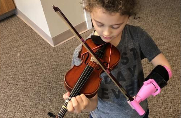 engineering student makes device for one handed girl violin