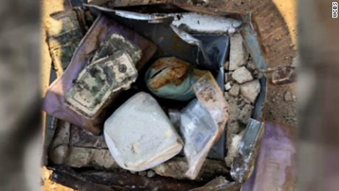 couple finds buried safe with money jewelry