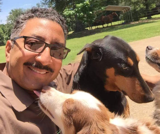UPS driver selfie with dogs