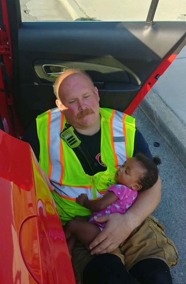 firefighter cradles baby after accident