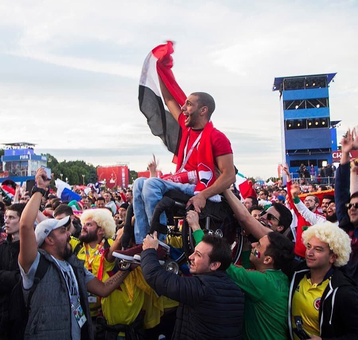 mexican and colombian fans hold up egyptian fan in wheelchair acts of kindness world cup
