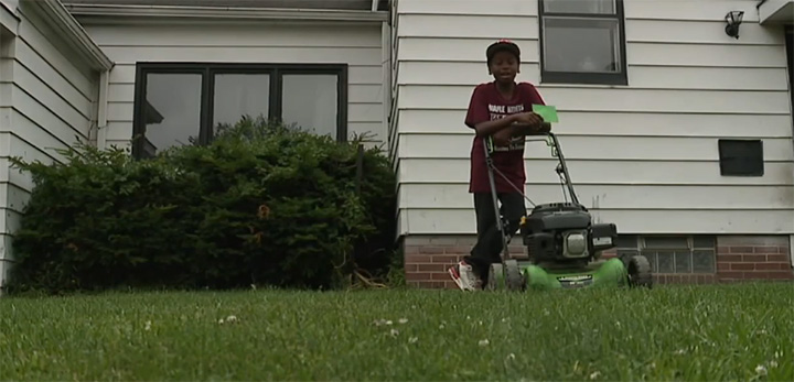 kid cuts grass police called business booming