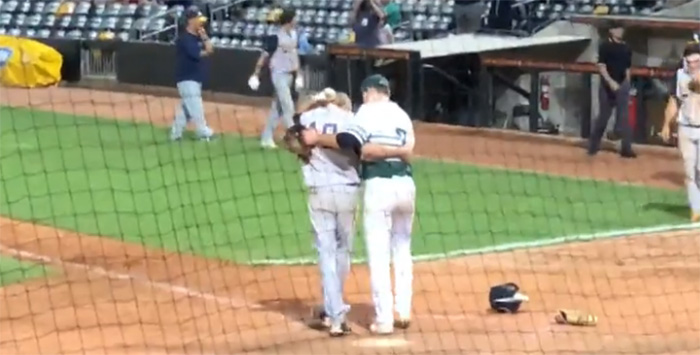 pitcher consoles childhood friend after strike out and win