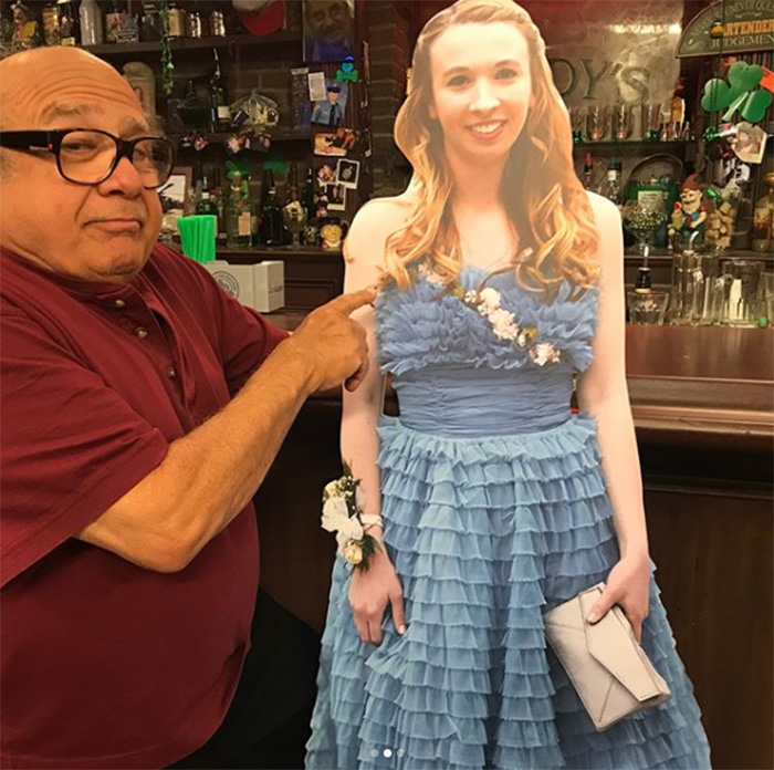 danny devito takes cutout of girl to bar prom