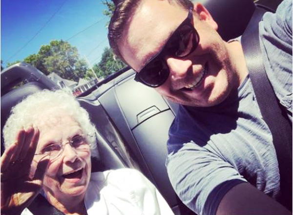 man takes elderly woman for spin while waiting for post office to open