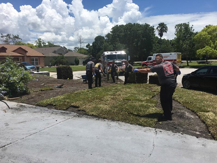 firefighters finish laying sod for man heart attack
