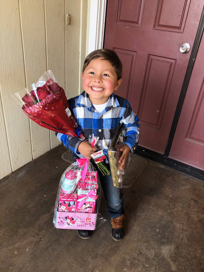 little boy so happy to give girlfriend gift on valentines day