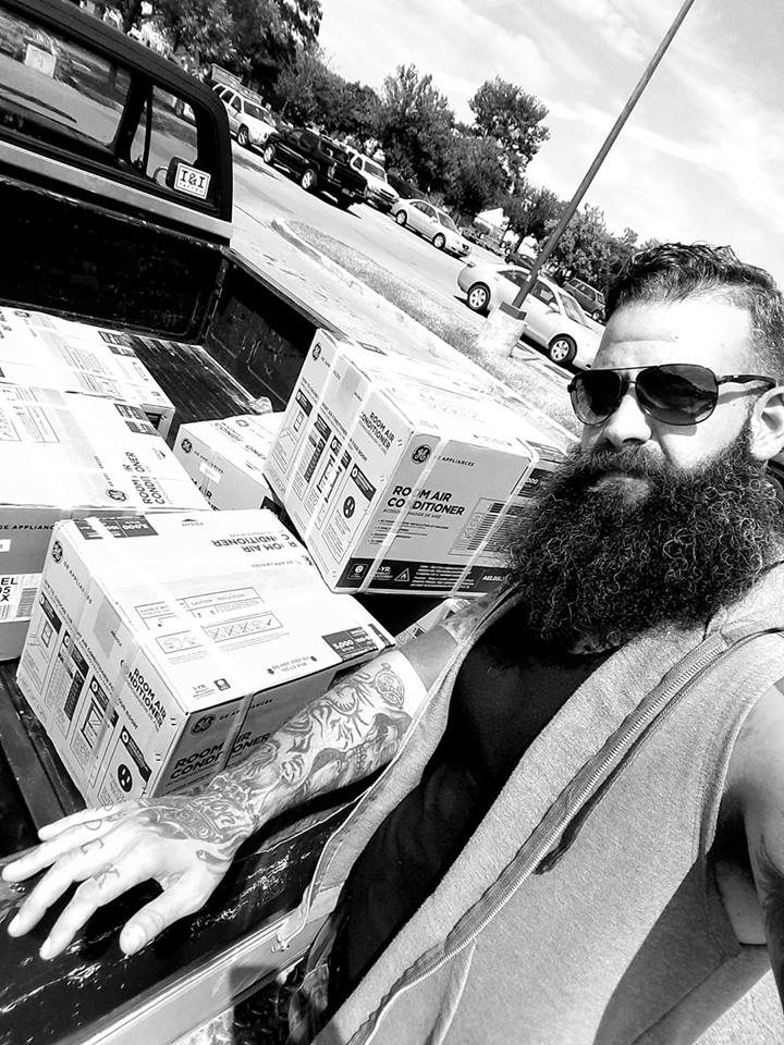 man buys AC units for people in need