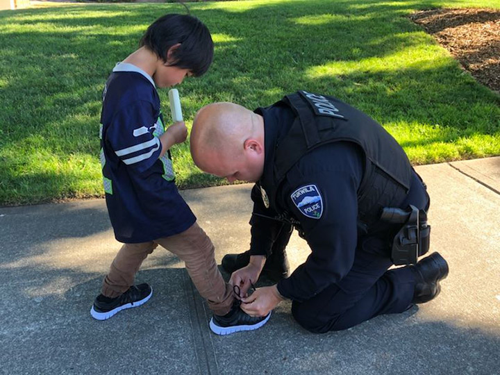 cop buys kid shoes