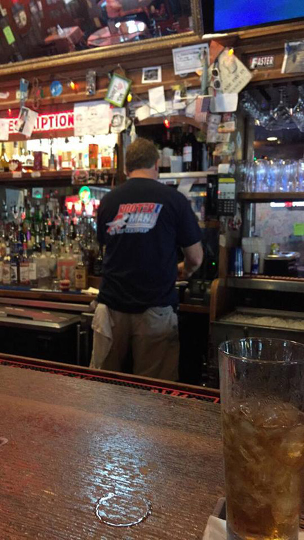 bartender serves homeless man