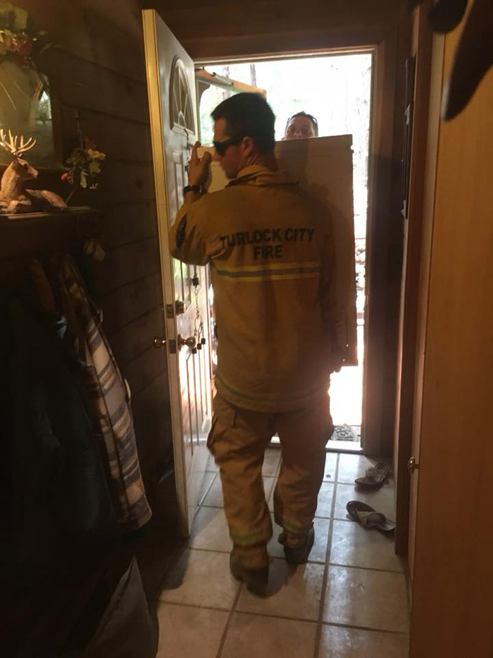 firefighters help woman