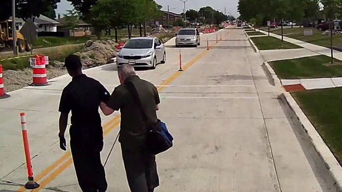 bus driver helps blind man cross the road