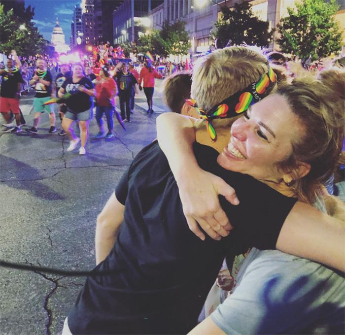 free mom and dad hugs church at pride