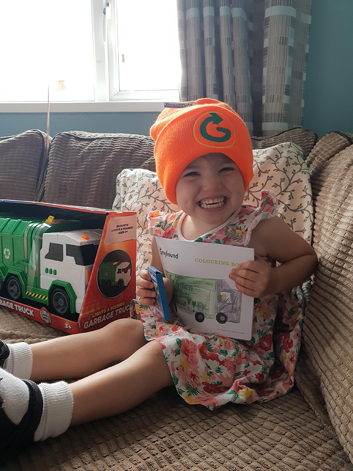 garbage men surprise little girl with present