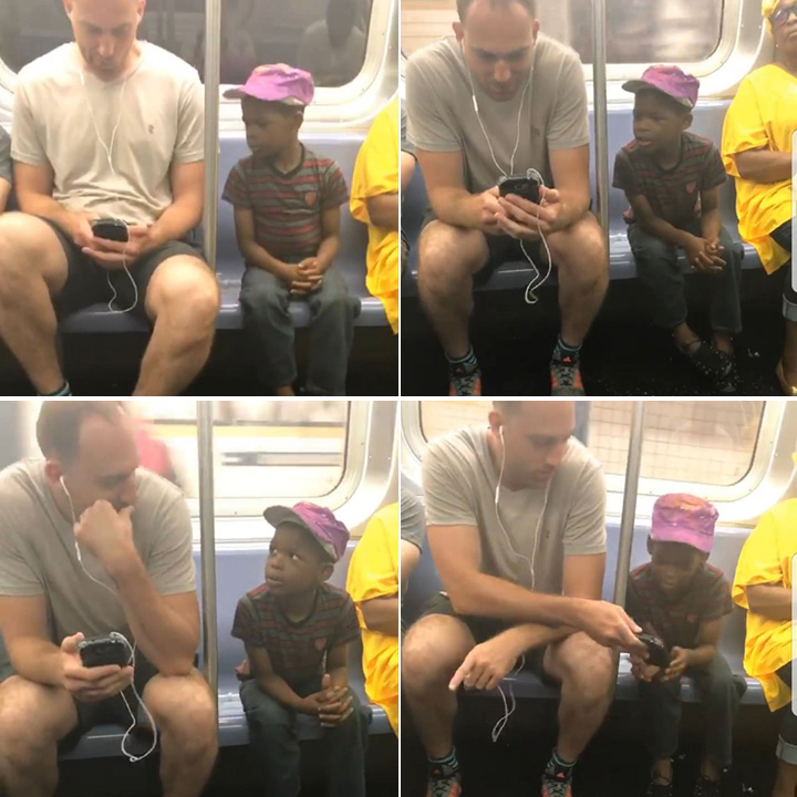 man gives kid his phone on train