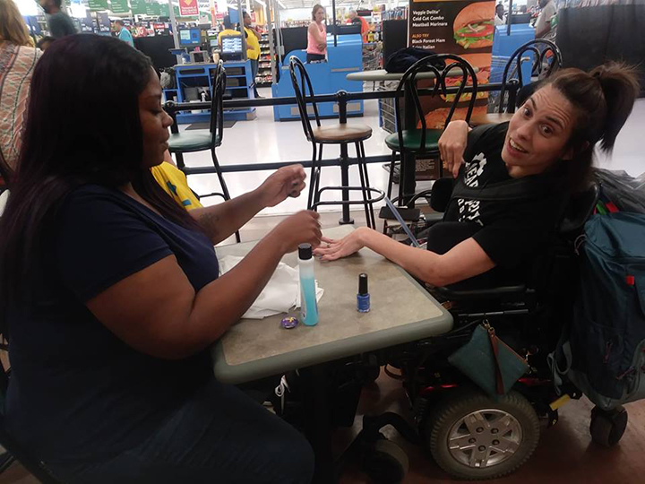 walmart cashier nails for woman in wheelchair