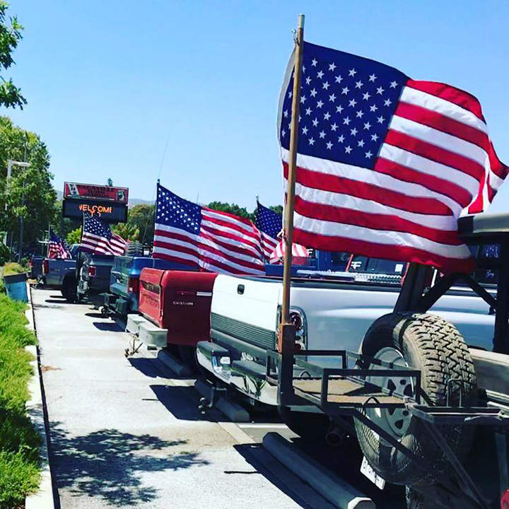 students honor fallen officer with flags