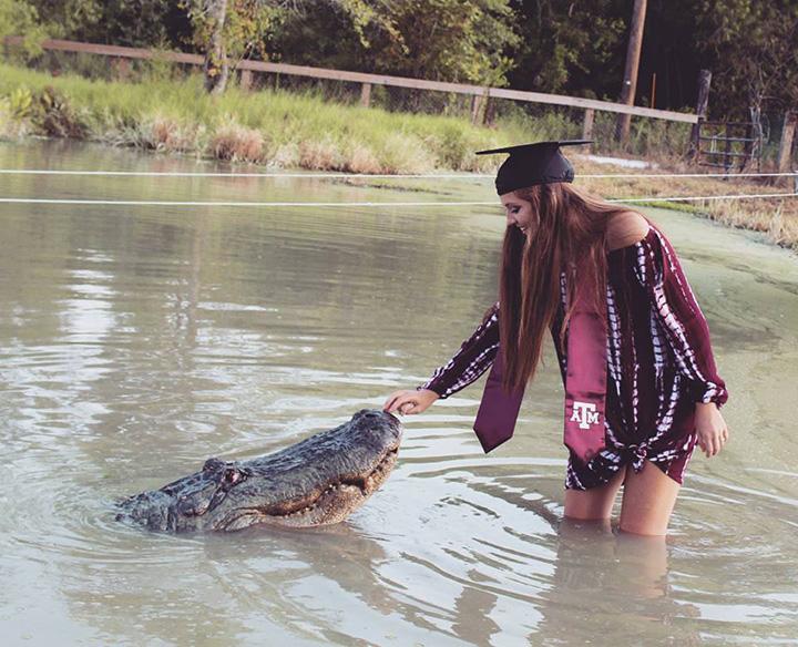 college grad poses with alligator
