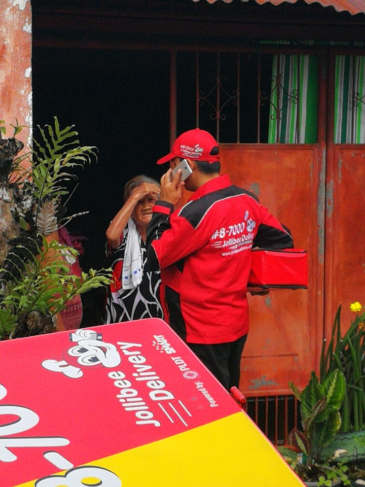 delivery man orders food for elderly woman