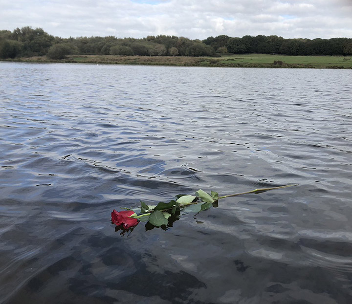 rowing coach rose in lake for grieving woman