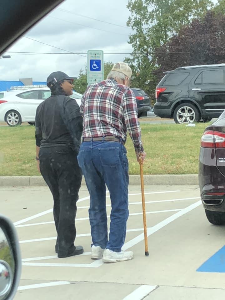 burger king employee walks old man to his car