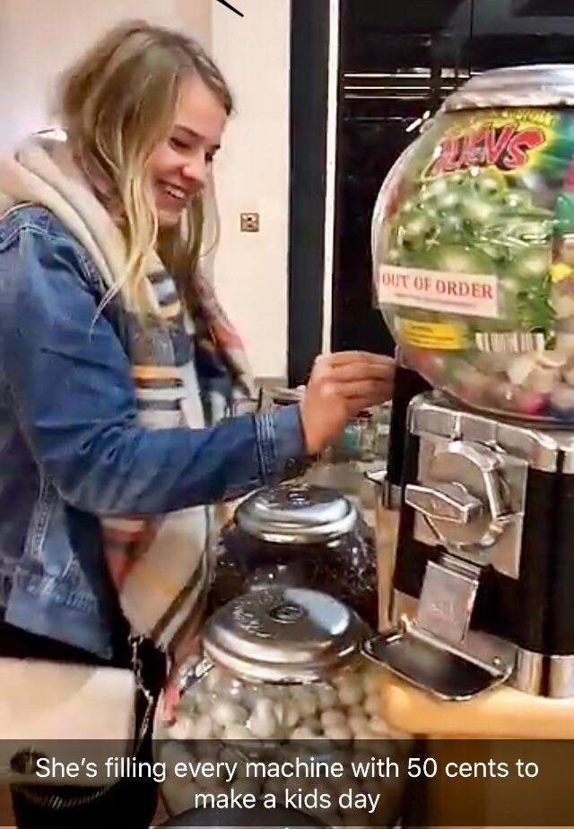girl fills candy machines with quarters for kids