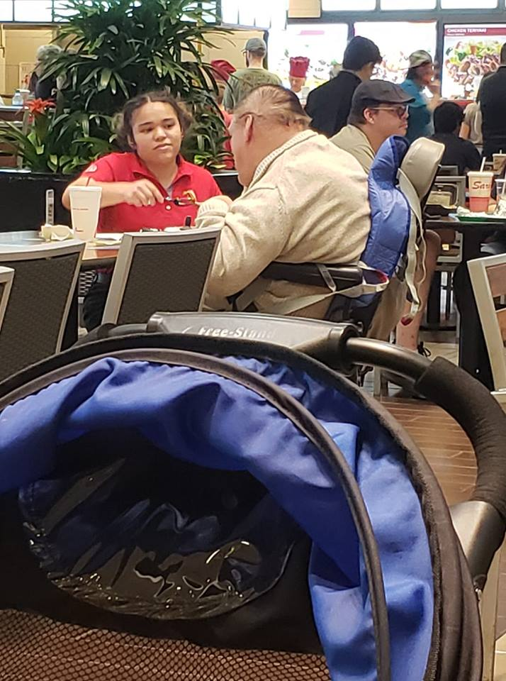 chic fila employee feeds disabled man