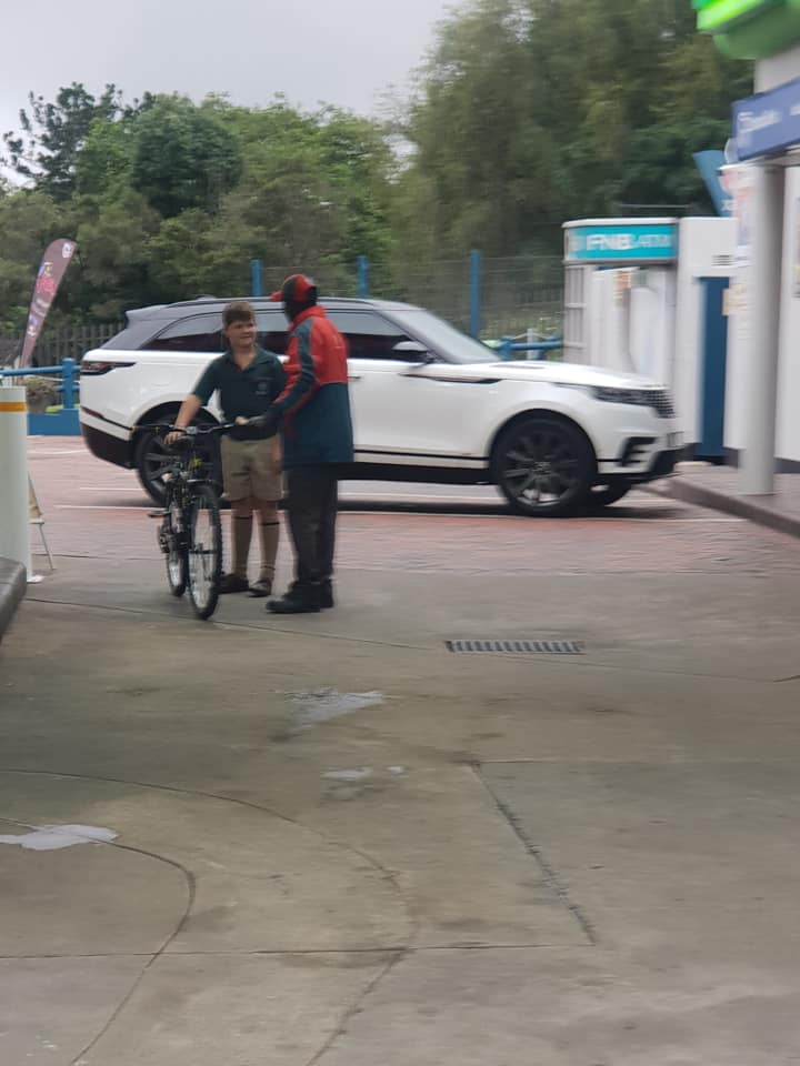 boy buys gas station worker bike