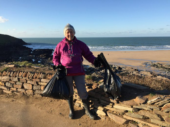grandmother cleans beaches