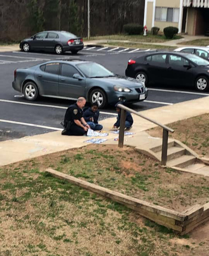 cop plays dolls with girls