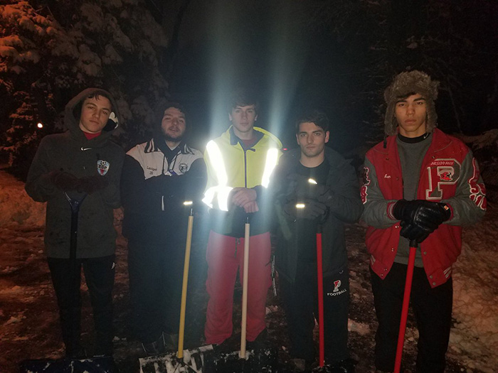 high school students shovel driveway at 4 am