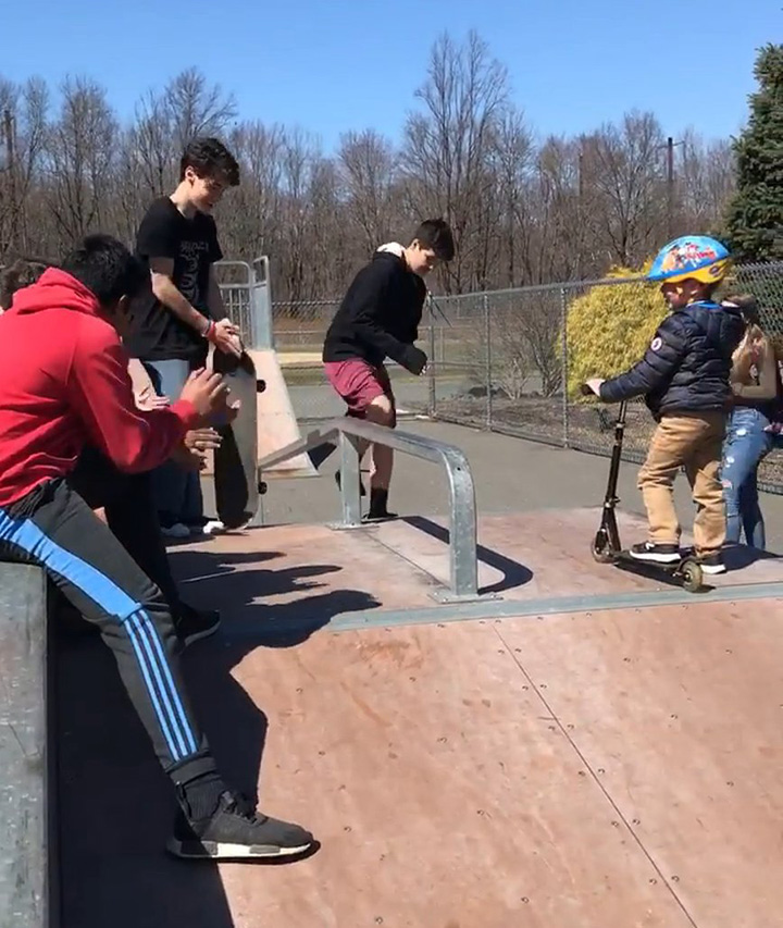 teens teach kid autism to skate