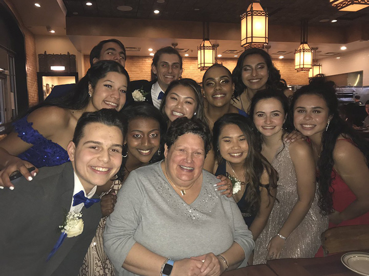 woman pays for dinner prom night