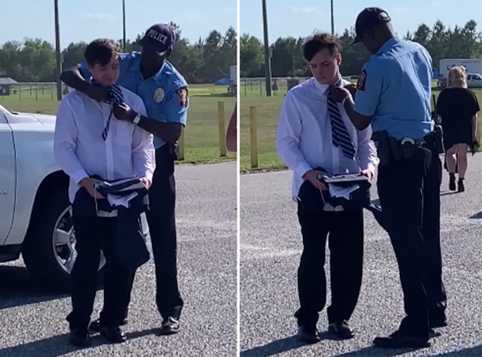 officer helps student with tie