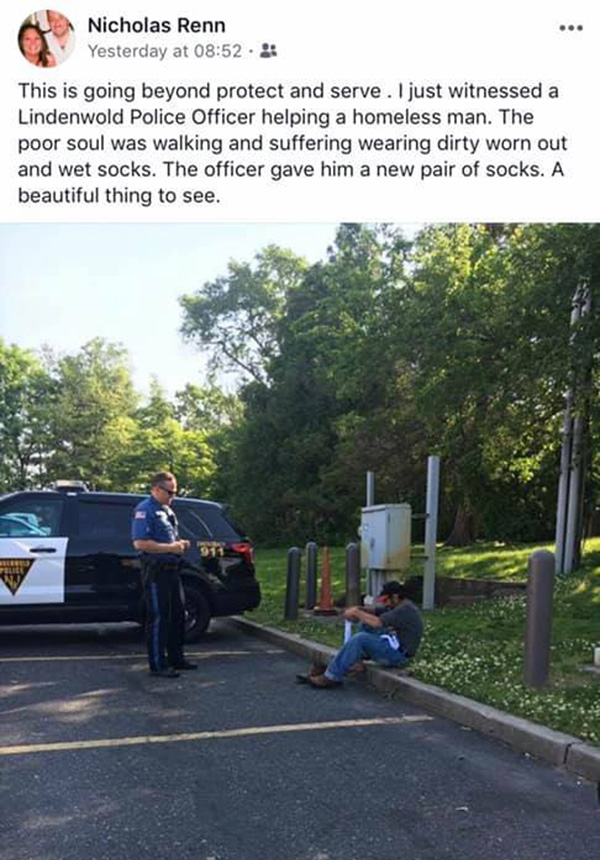 cop gives homeless man socks