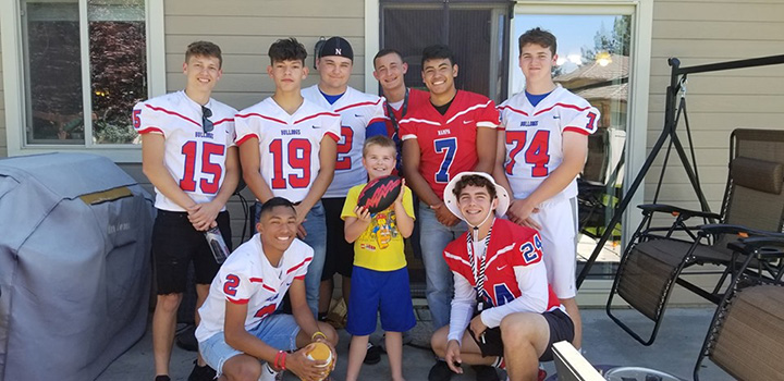 football team shows up to kids birthday autism