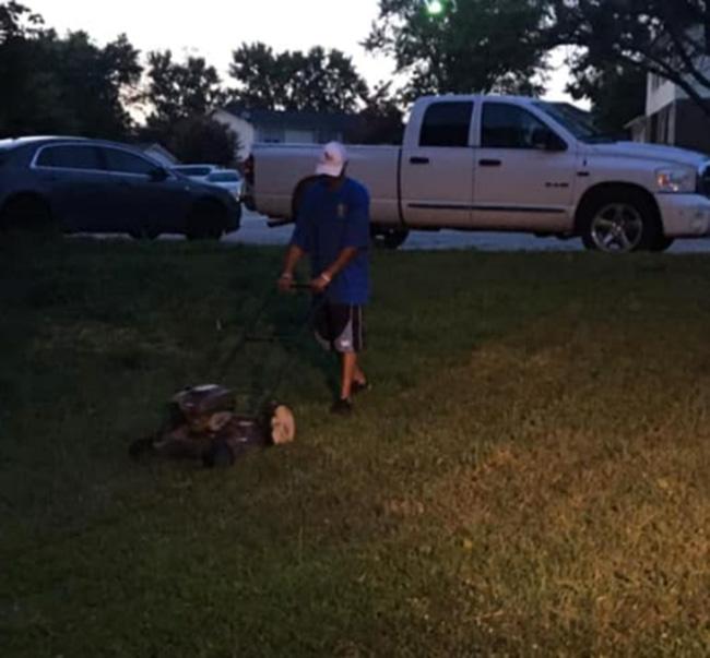 man mows lawn for free