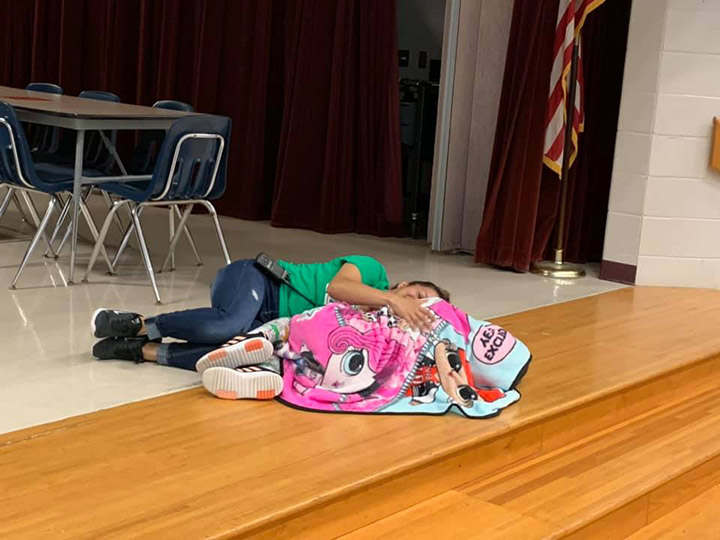 janitor lays down with student comfort