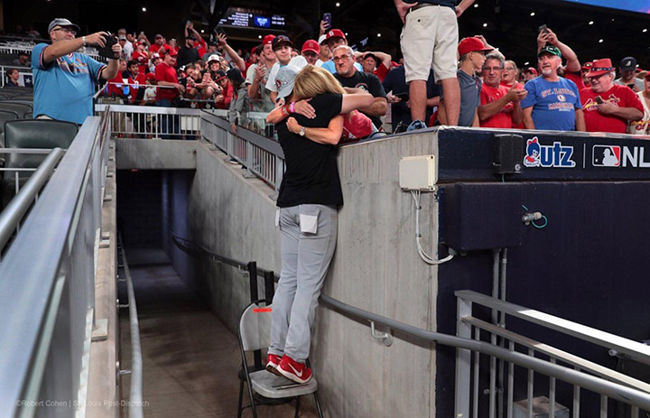 pitcher hugs mom after win